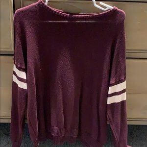 Maroon sweater with white stripes